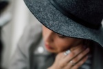 girl praying with hat